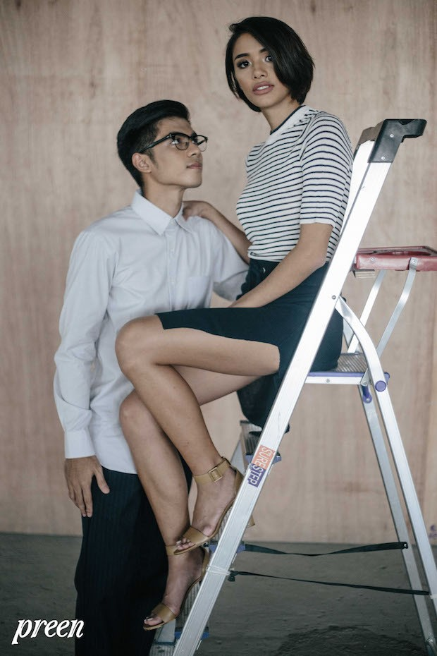 Kimi wears a striped knit top and drawstring skirt with slit both from H&M with heels from Charles & Keith. Thomas wears a graphic button-down and pinstripe jogger pants, both from Uniqlo.
