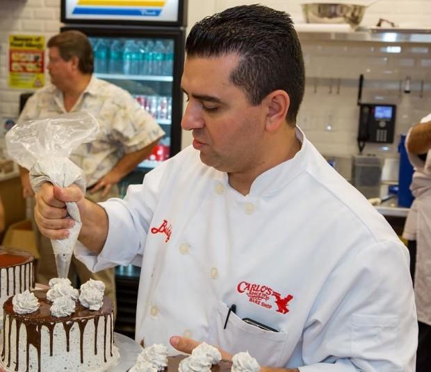 cake boss buddy valastro decorating a cake