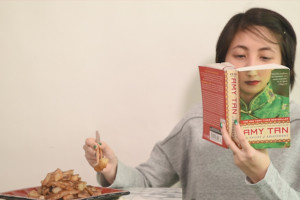 girl reading a book and eating tikoy