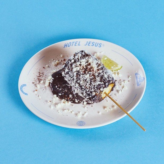 Corn black mayo topped with cheese is the perfect side to any taco dish.