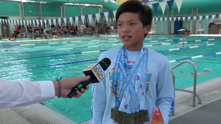 Ten-year-old 'Superman' bests Phelps' 23-year-old swim record
