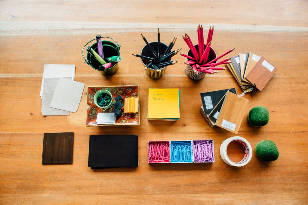 """Keep your workspace clutter-free by having a catch-all for clips, a jar for pens, a file rack for the folders, and a paper tray for sorting paperwork. """"When you have a space for everything, you'll be obsessed with keeping everything in place,"""" Cheska says."""